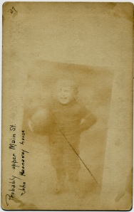 Ghost image of a little boy holding a ball