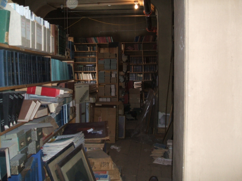 Cluttered, dirty attic with no room to walk, March 2007.